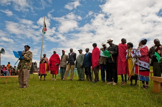 "Maasai elder announcing the new ""katiba' (constitution) protecting and supporting the rights of women and girls."