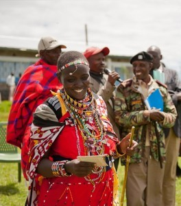 A Maasai woman reads the new katiba after the announcement.