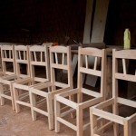 "Before Evariste received his land title, he could only ""make one chair at a time, make, sell, make, sell."" His customers had a significant wait before he could fulfill their order.  But now he can make eight chairs at a time.  
