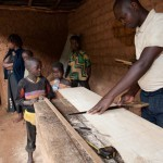 The land title made it possible for Evariste, father of five, to obtain a loan from the bank. And with this loan, he was able to build a carpentry workshop to protect his handy work from the rain.  | Photo © Deborah Espinosa