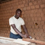 A simple piece of paper allowed Rwandan farmer and carpenter Evariste Hagumimana to substantially expand his carpentry business. That paper was a land title. | Photo © Deborah Espinosa