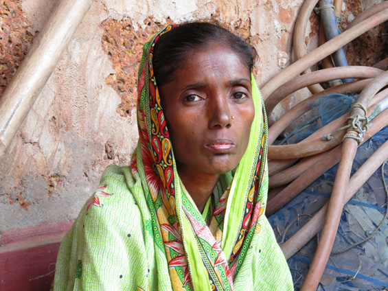 """Kuntala looks much older than her 35 years. """"Food is a daily struggle and depends on my son finding daily work,"""" she says. With most of what her son brings home going for rent, she hopes a land title will allow her to build a hut and have more food on the table."""